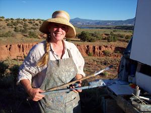 using a trowel to paint a landscape