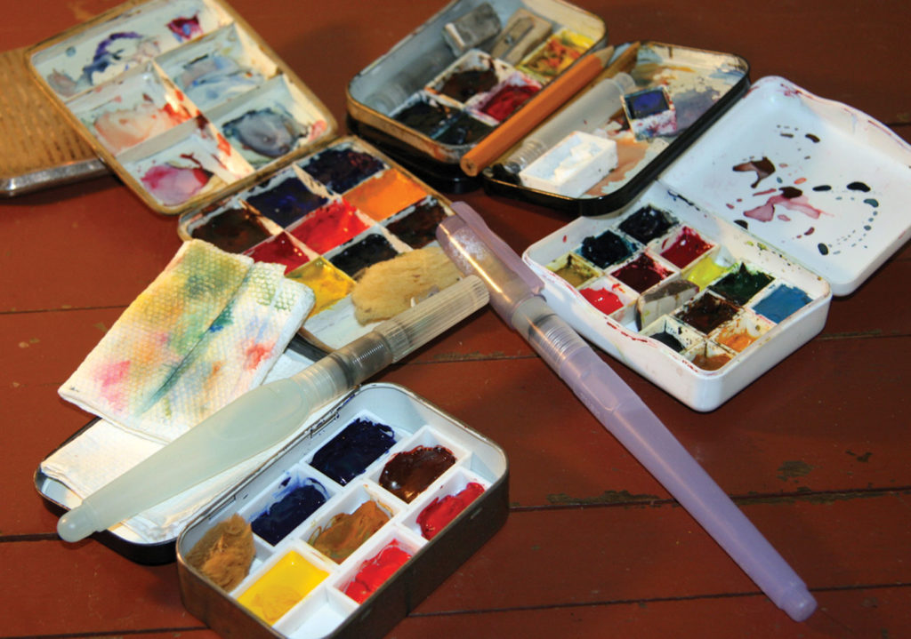 You can make a simple watercolor kit with an empty candy tin or cough drop box and fi ll it with colors of your choice. A watercolor crayon tin also makes a good kit. Use your imagination.