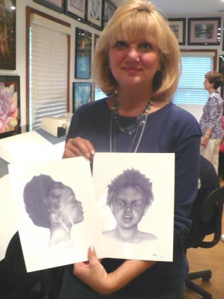 I'm holding a drawing of a little girl who couldn't be identified.  I drew her portrait from her autopsy photos.