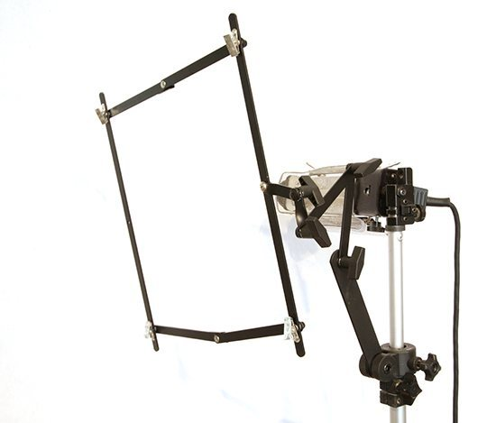 Film holder frame attached to my light stand. Understanding how to shoot your art leads to understandings of how to turn photos into paintings.