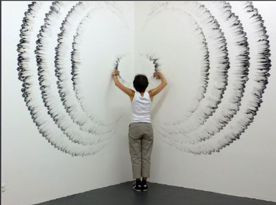 Fingering #5 by Judith Braun, drawn on wall with fingers dipped in charcoal, 9 x 16, 2010.
