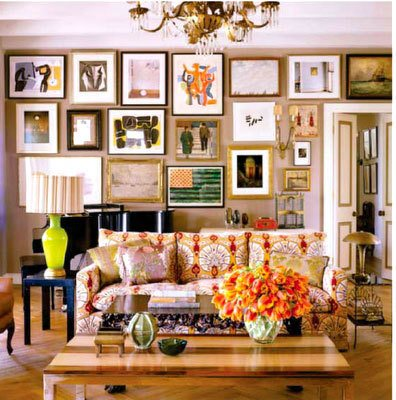Paintings hung salon style create an all-over effect--nothing quite sticks out.