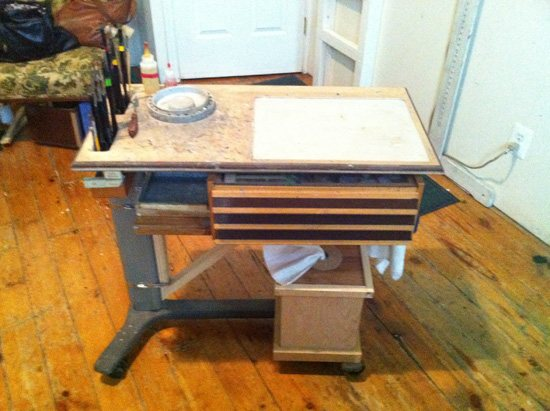 Daniel Baltzer's repurposed hospital table makes a great transportable palette, storage container, and brush holder. All in one!