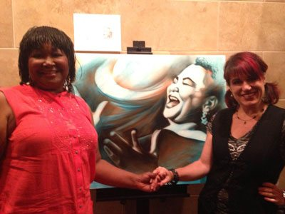 Shen and the amazing singer, Ms. Hazel Miller, after painting her at a live event.