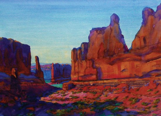 The colors in this work, Wall Street--Arches, Utah, by Carl Dalio, call to mind the scorching heat of a summer day, as opposed to the more delicate hints of color that accompany spring.