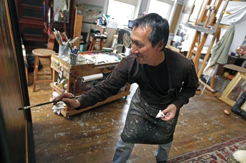 Oil painter Quang Ho at his easel.