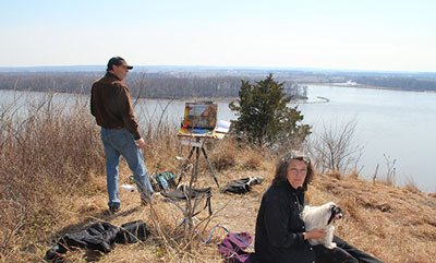 Ann, Cella, and I overlooking the Mississippi River during a plein air painting session.