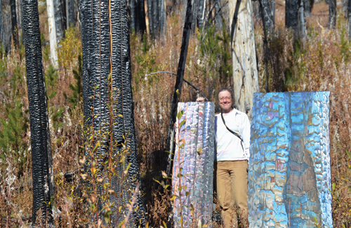 The artist with paintings (L-to-R:) What Remains (varnished watercolor on shaped paper, mounted on Fome-Cor, 51x20) and Okanagan Mountain Hollow (varnished watercolor on shaped paper, mounted on Fome-Cor, 51x20) | tree paintings