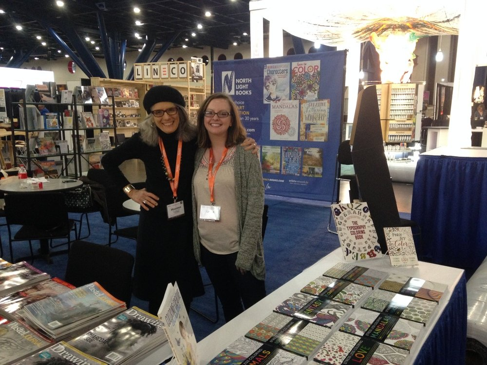 Maureen Bloomfield and Laura Wooffitt at the F+W booth