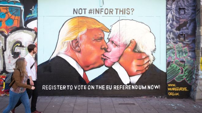 Political art: street art of Trump kissing Boris Johnson