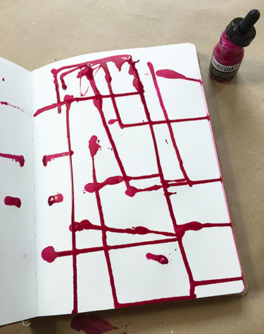 Acrylic ink dripped on an art journal page