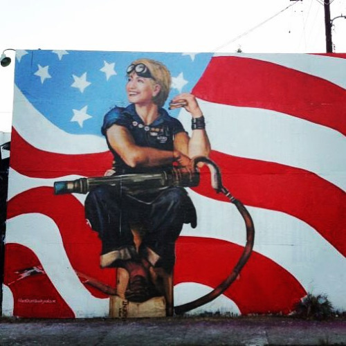Political art: Hillary with flame thrower street art