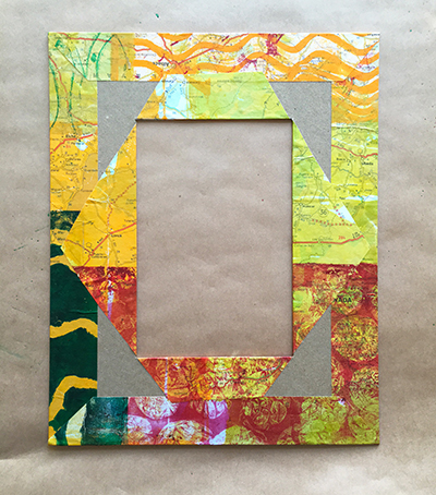 Covering a chipboard frame with paper