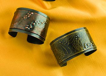 Etched metal bracelets by Carol Geurts