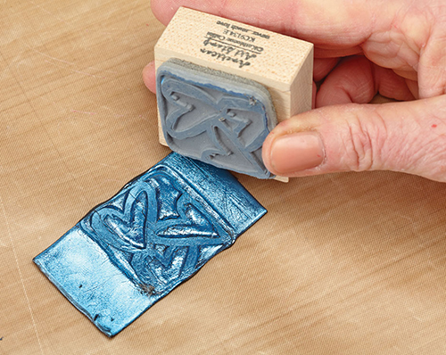 Stamping on moldable plastic, from the book Mixed Media in Clay