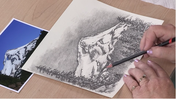 Use pencil direction and paper stumps for landscape pencil drawings of trees in the distance.
