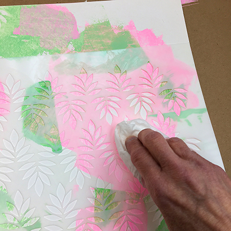 Removing acrylic paint through a stencil
