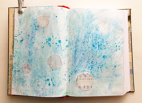 Gesso coat over paint and collage on a mixed-media planner spread