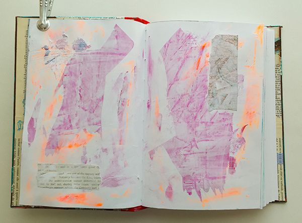 Gesso layer over paint on a mixed-media planner spread