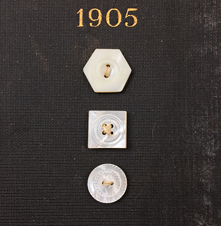 Buttons make useful and versatile vintage art materials.