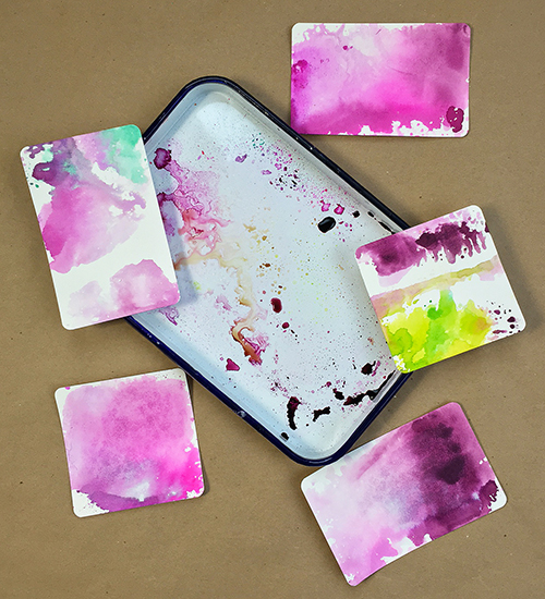 Dyeing watercolor paper with spray inks