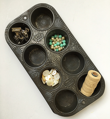 Vintage muffin tin for holding art supplies