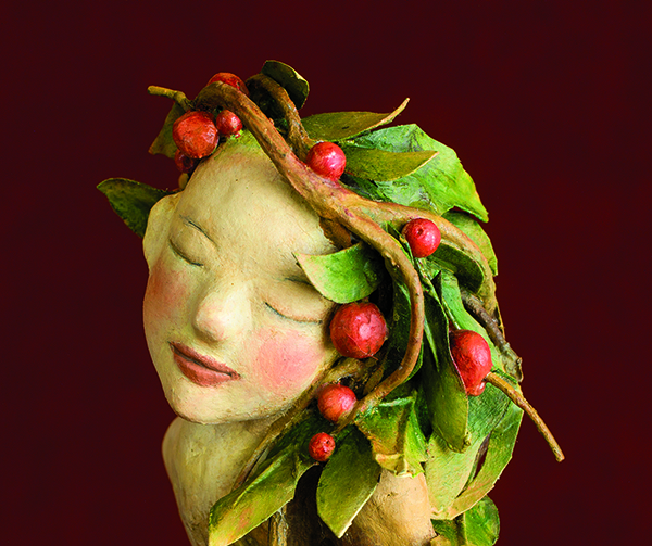 Air-dry clay can be used to create sculpted mixed-media faces.