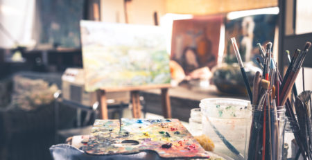 Image of Painting Palette with Brushes in Artist's Studio -- Photo by Getty Images | Article: 8 Beginner Painting Mistakes and How to Conquer Them | Artists Network