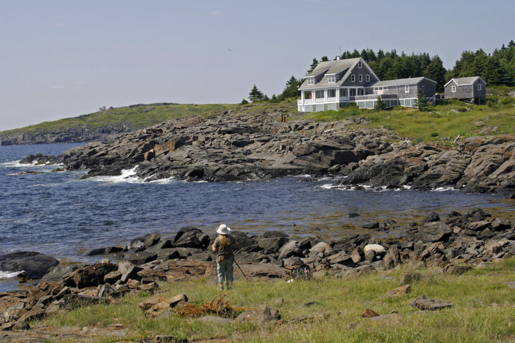 Artist painting on Monhegan Island, Maine, photo by Getty Images | 10 Places to Paint en Plein Air | Artists Network