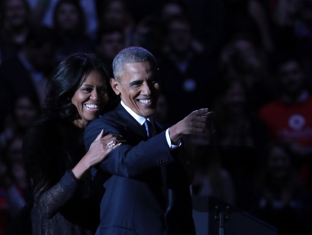 CHICAGO, UNITED STATES - JANUARY 10 : U.S. President Barack Obama greets daughter Malia (not seen) and first lady Michelle Obama on stage after delivering his farewell address at the McCormick Place, the largest convention center in North America, on January 10, 2017 in Chicago, United States. (Photo by Bilgin Sasmaz/Anadolu Agency/Getty Images)
