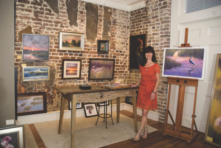 Cecilia Murray posing in her art gallery, Cecil Byrne Gallery, located in Charleston, South Carolina