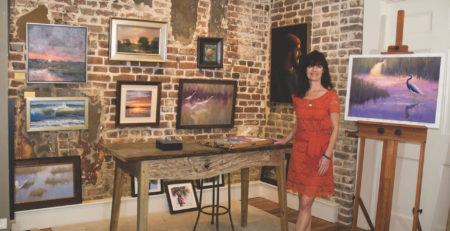 Cecilia Murray posing in her art gallery, Cecil Byrne Gallery, located in Charleston, South Carolina.