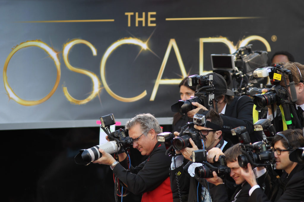 Oscars Time: Photographers cover the red carpet arrivals to the 85th Annual Academy Awards in Hollywood, California. (Photo by David McNew/Getty Images)
