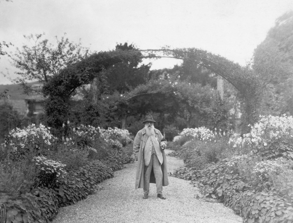 Monet in his garden at Giverny, France. (Photo by George Rinhart/Corbis via Getty Images)