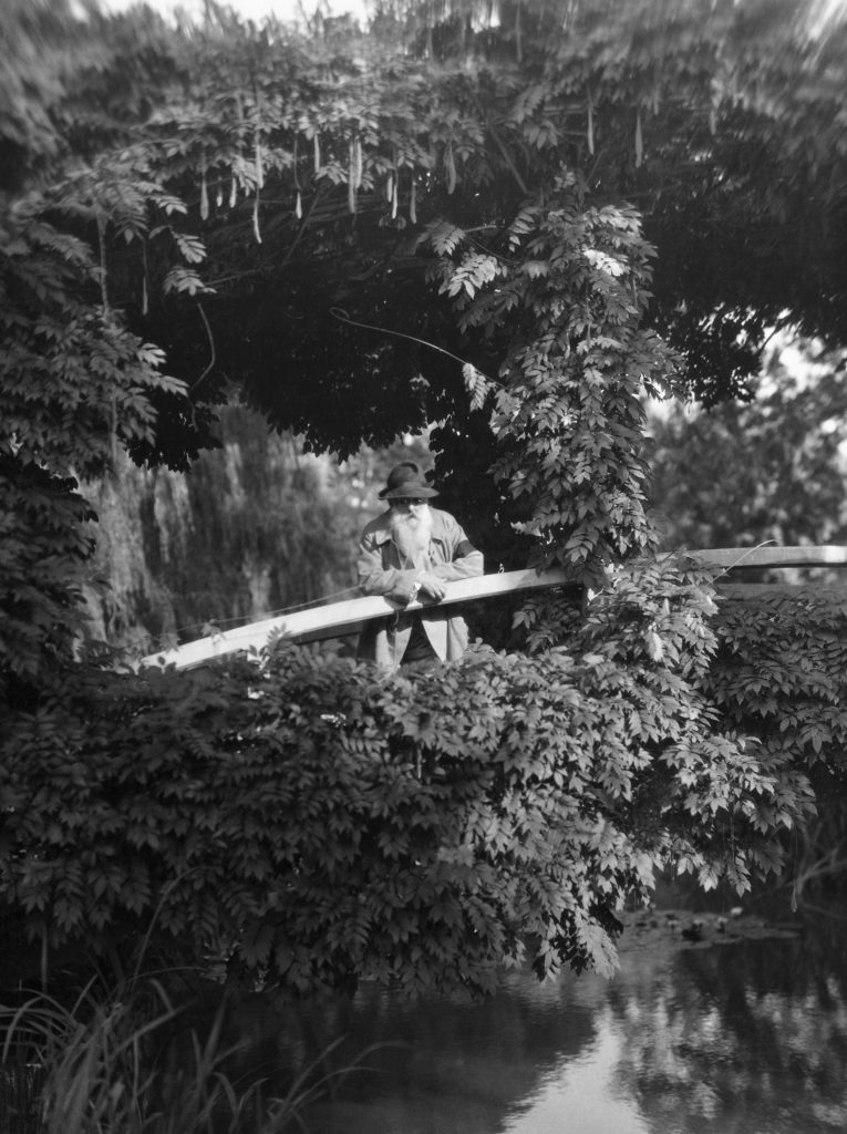 Claude Monet shown in his garden at his home in Giverny. (Photo by George Rinhart/Corbis via Getty Images)