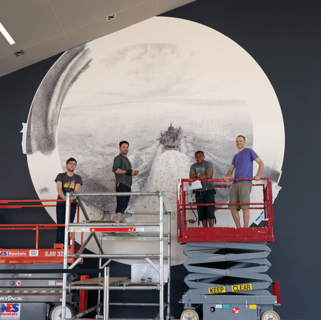 Ethan Murrow and crew mid-installation.