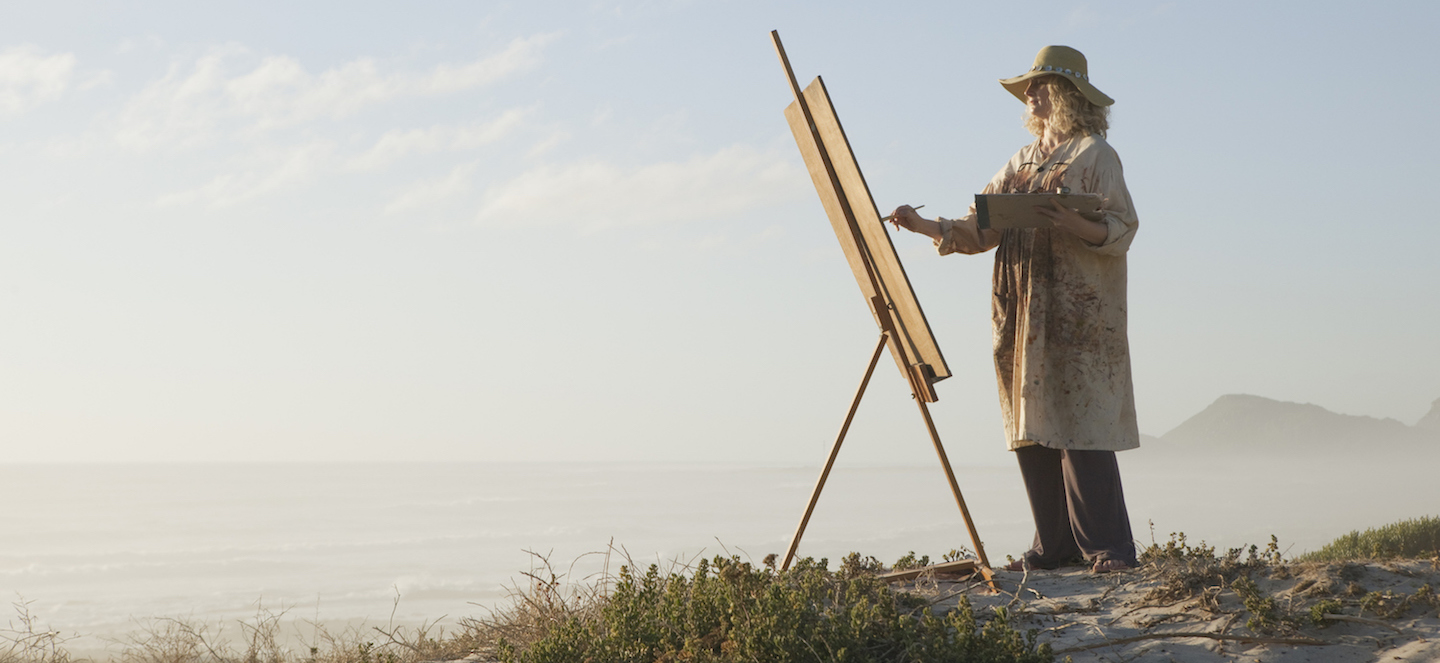 (Cropped) Photo of female painter outdoors, courtesy of Getty Images | Why Artist Retreats Are So Important | Artists Network