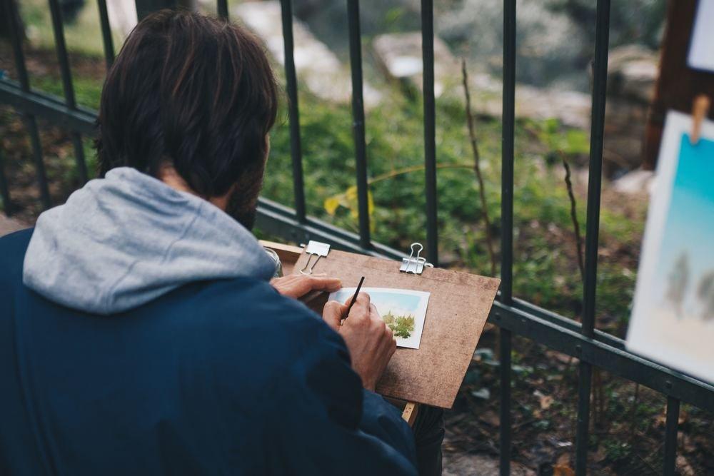 Highly satisfied artists have secrets. Photo by Luke Porter on Unsplash