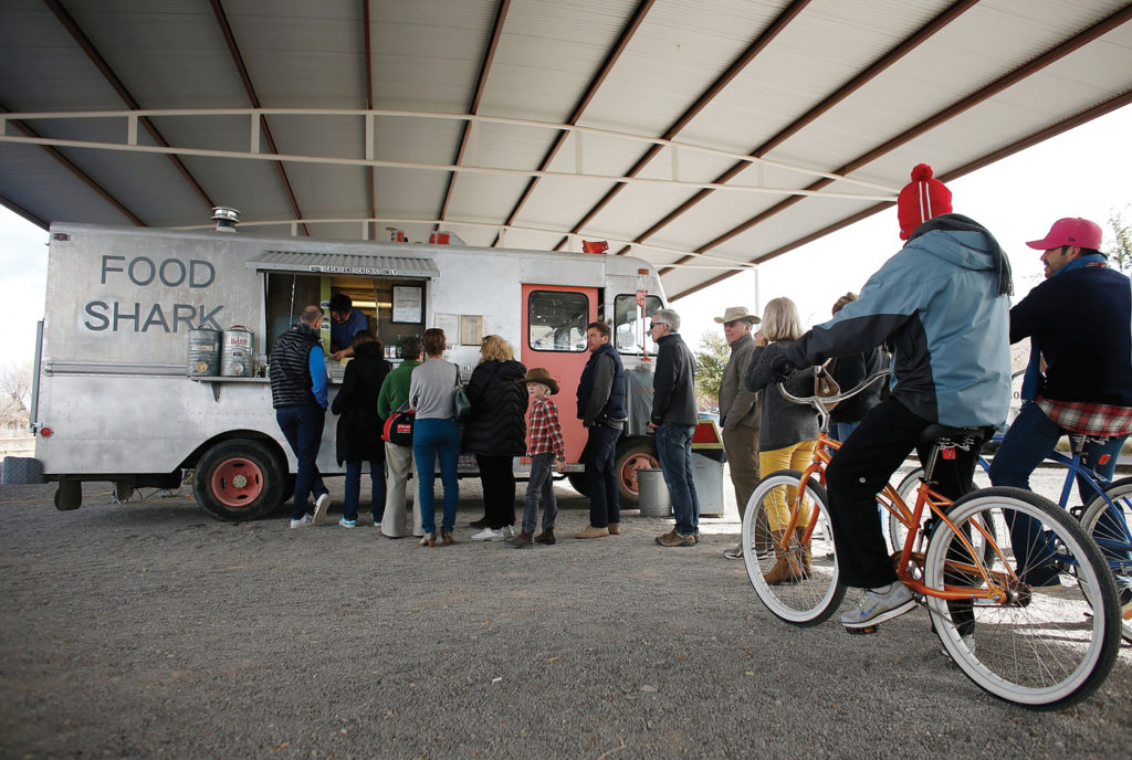 Diners wait to order from the Food Shark food truck on Marfa's Highland Avenue. Scott Halleran / Getty Images