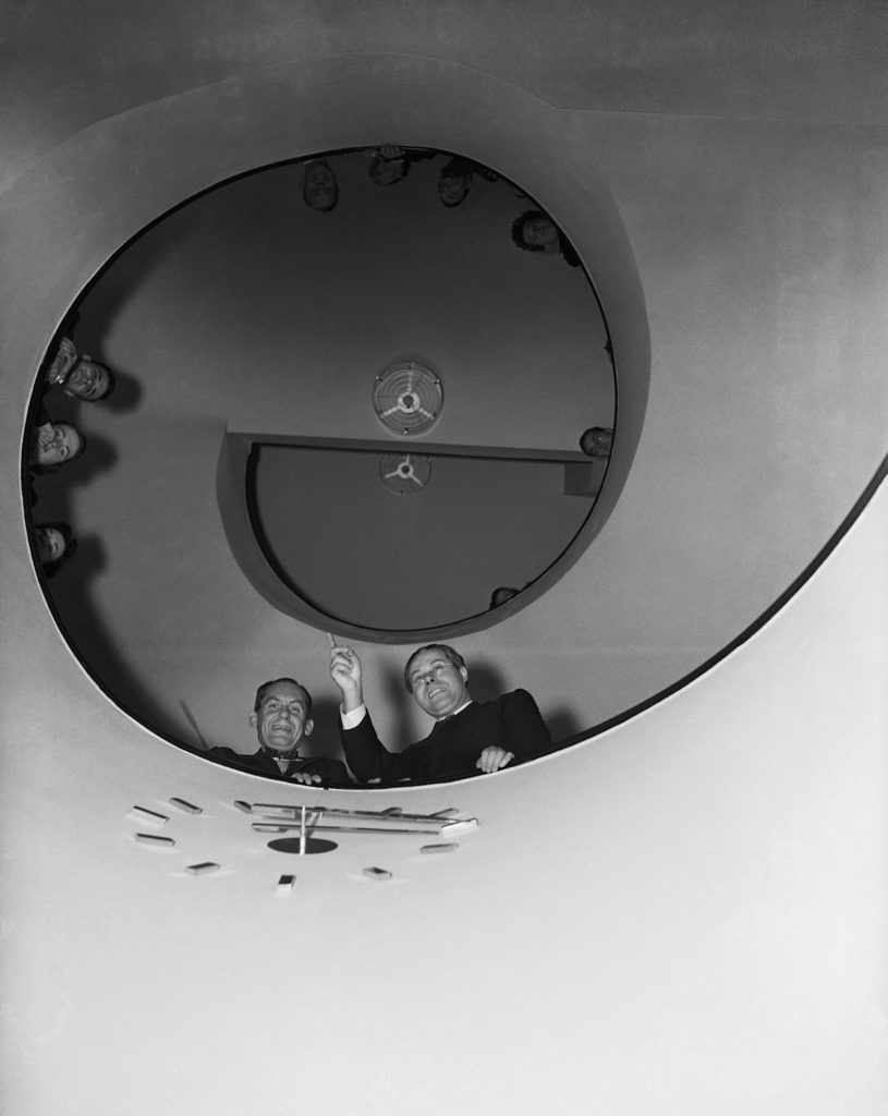 In 1937, former Bauhaus instructor Moholy-Nagy (lower right) started a design school in Chicago named the New Bauhaus (now the ITT Institute of Design). In this photo, Gropius (beside Moholy-Nagy) and students stand on the circular staircase of the school's first headquarters— originally the Marshall Field mansion. Getty Images