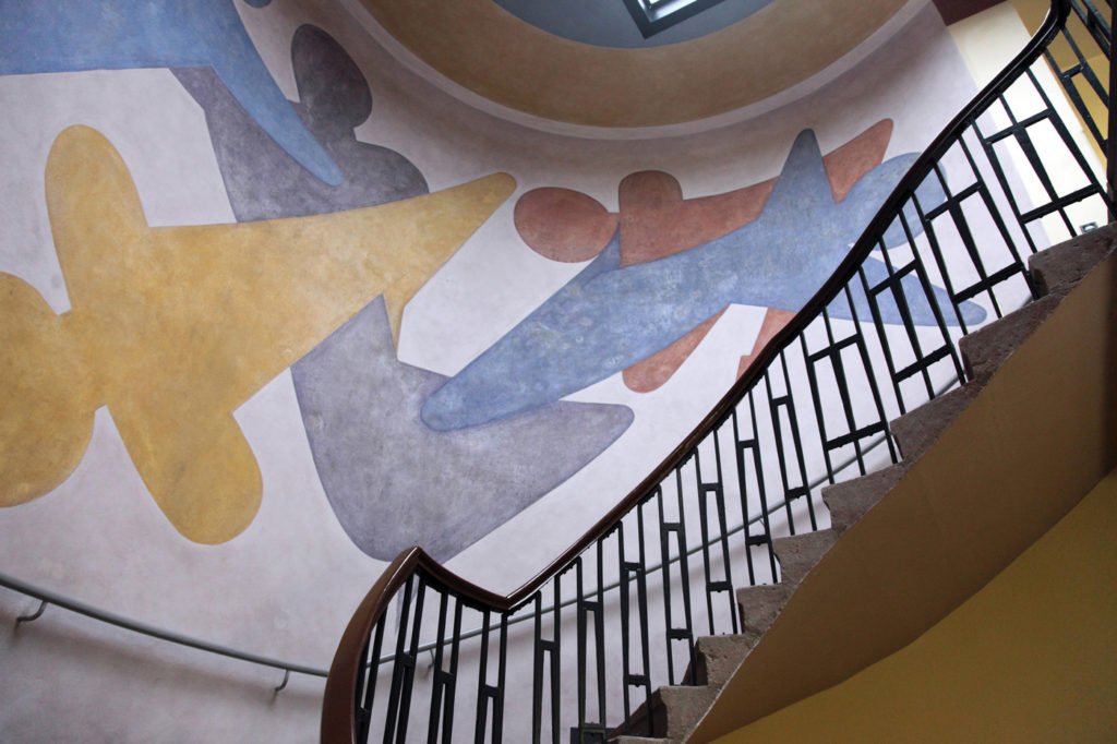 Oskar Schlemmer, who served as Master of Form at the Bauhaus theatre workshop, painted this mural in 1923 at the Weimer location of the Bauhaus (now Bauhaus University, Weimer). Loop Images/UIG/Getty Images