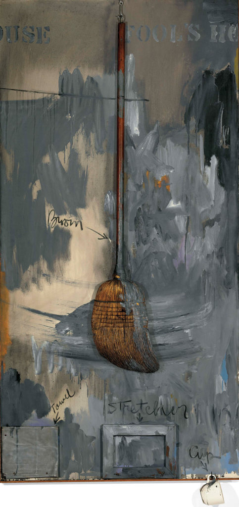 Fool's House 1961–62; oil on canvas with broom, sculptural towel, stretcher and cup, 72 x 36⅜ x 4½. PRIVATE COLLECTION. ART ©JASPER JOHNS/ LICENSED BY VAGA, NEW YORK, NY