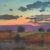 Saturated washes of watercolor are enriched with delicate applications of pastel to create active, broken color in Twilight, New Mexico by Tom Perkins (mixed media on paper, 20x20).