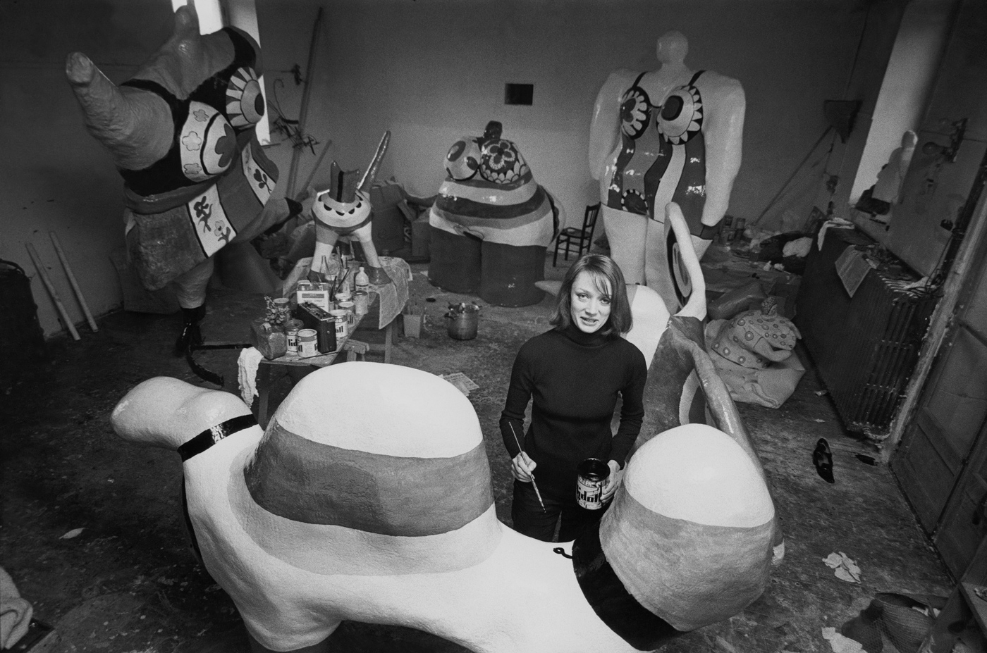 Niki de Saint Phalle at work on Nanas in her studio on the outskirts of Paris, in 1971