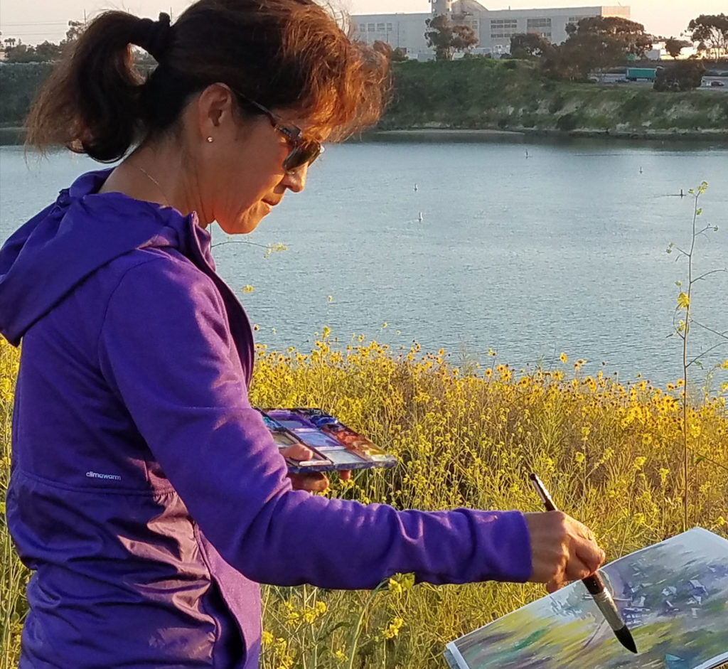 Keiko Tanabe at work on a recent landscape watercolor painting.